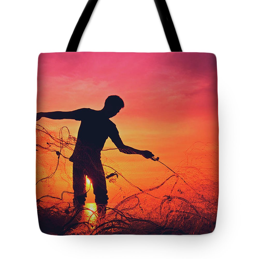 Active Tote Bag featuring the photograph Silhouette Of A Local Fisherman Collecting His Nets On The Beach At The Sunset On Koh Lanta Island by Srdjan Kirtic