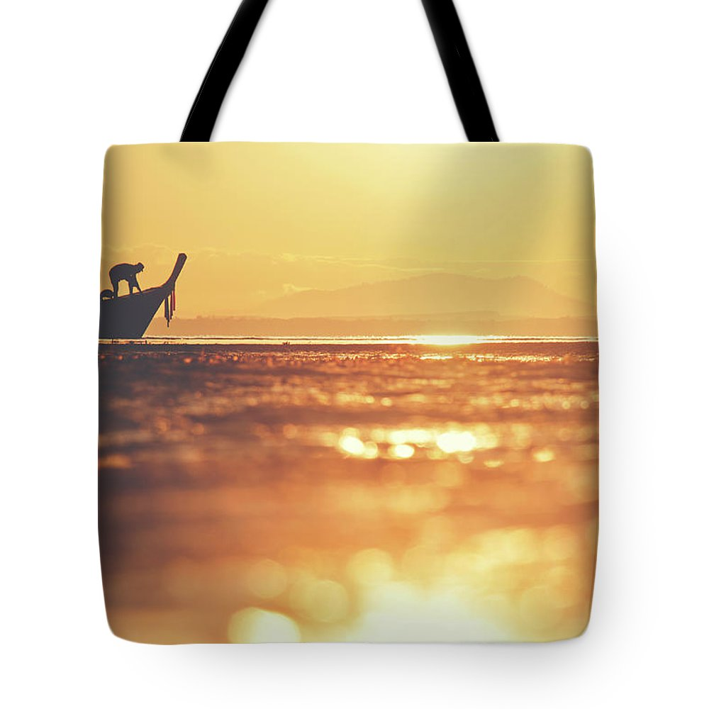 Background Tote Bag featuring the photograph Silhouette Of A Thai Fisherman Wooden Boat Longtail During Beautiful Sunrise by Srdjan Kirtic