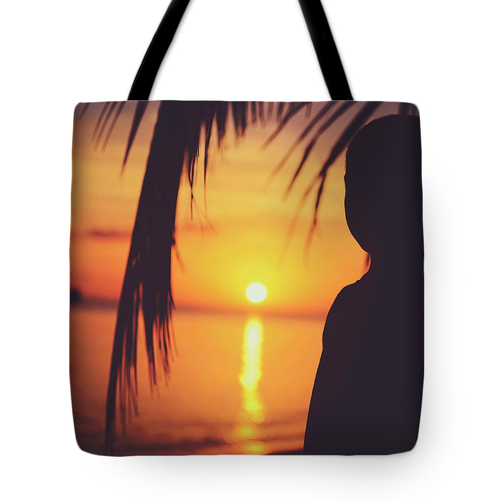 Awe Tote Bag featuring the photograph Silhouette Of A Young Boy Watching Beautiful Caribbean Sunset by Srdjan Kirtic