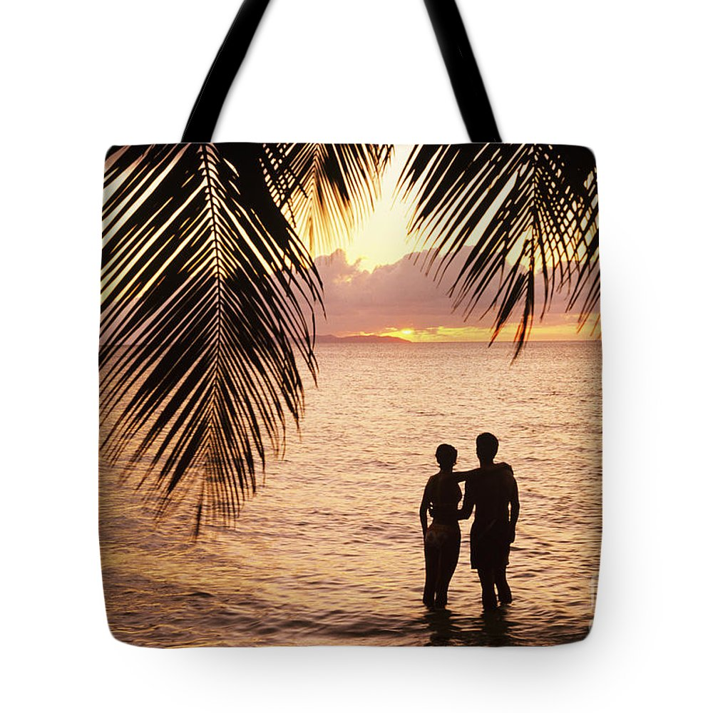 Bay Islands Tote Bag featuring the photograph Silhouetted Couple by Larry Dale Gordon - Printscapes