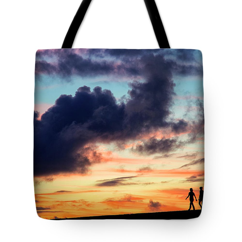 Silhouette Tote Bag featuring the photograph Silhouettes Of Three Girls Walking In The Sunset by Fabrizio Troiani