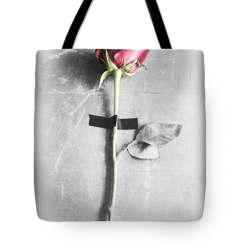 One Tote Bag featuring the photograph Single Rose Stem Taped On White Background by Di Kerpan