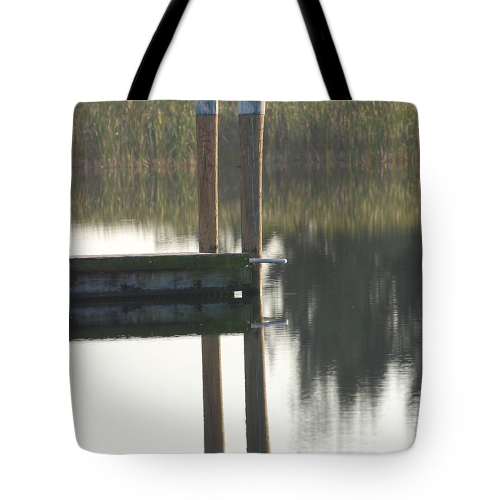Grass Tote Bag featuring the photograph Sitting Bird by Rob Hans