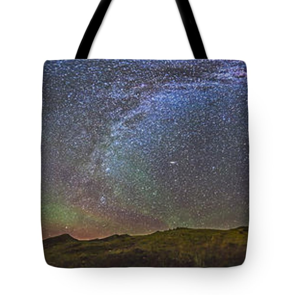 70 Mile Butte Tote Bag featuring the photograph Skygazer Standing Under The Stars by Alan Dyer