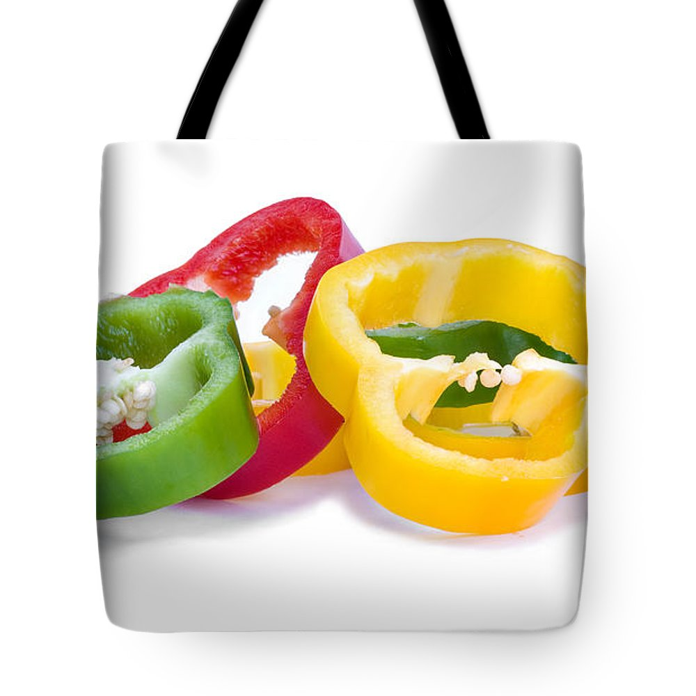 Bulbous Tote Bag featuring the photograph Sliced Colorful Peppers by Meirion Matthias