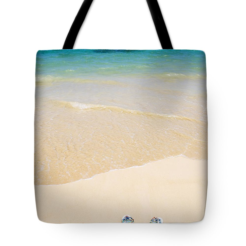 Beach Tote Bag featuring the photograph Slippers In The Sand by Tomas del Amo - Printscapes