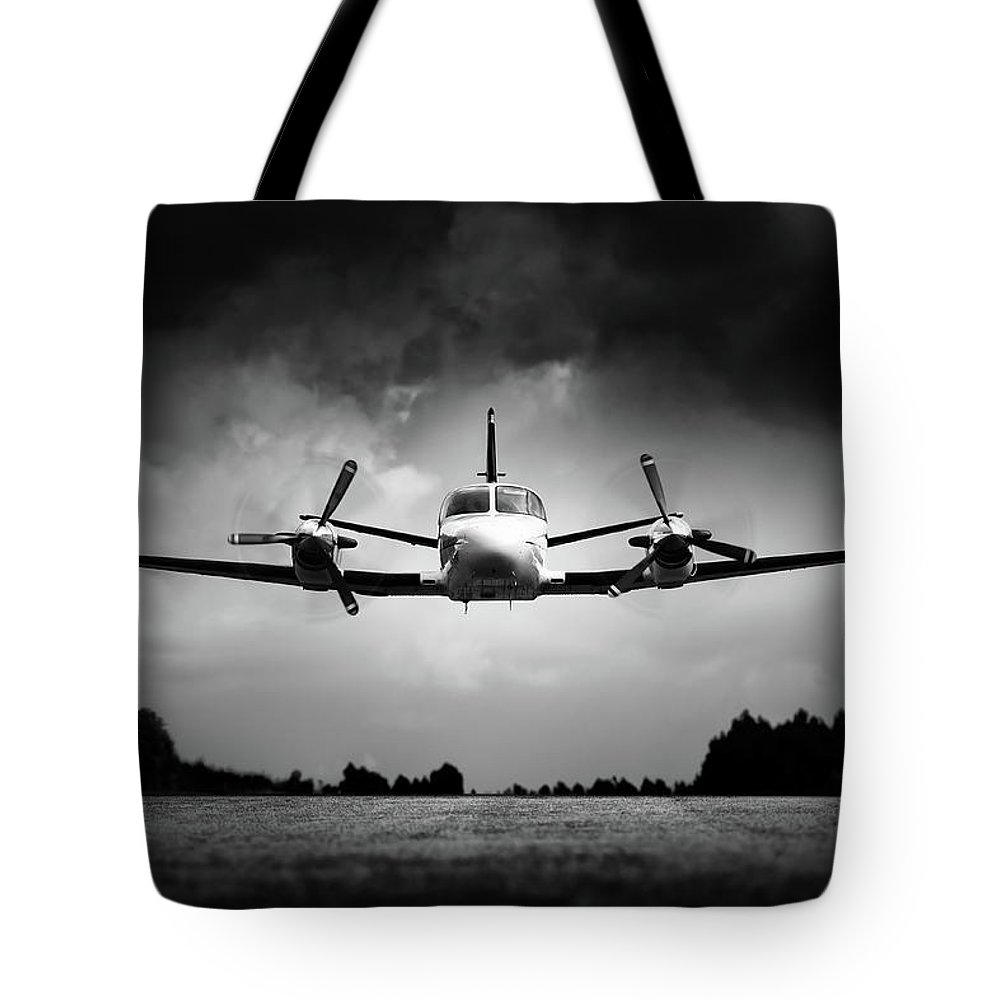 Airplane Tote Bag featuring the photograph Small Airplane Low Flyby by Johan Swanepoel