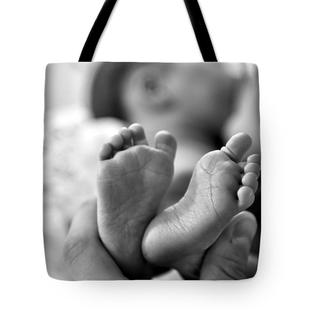 Babies Feet Tote Bag featuring the photograph Small And Cute by Jeramey Lende
