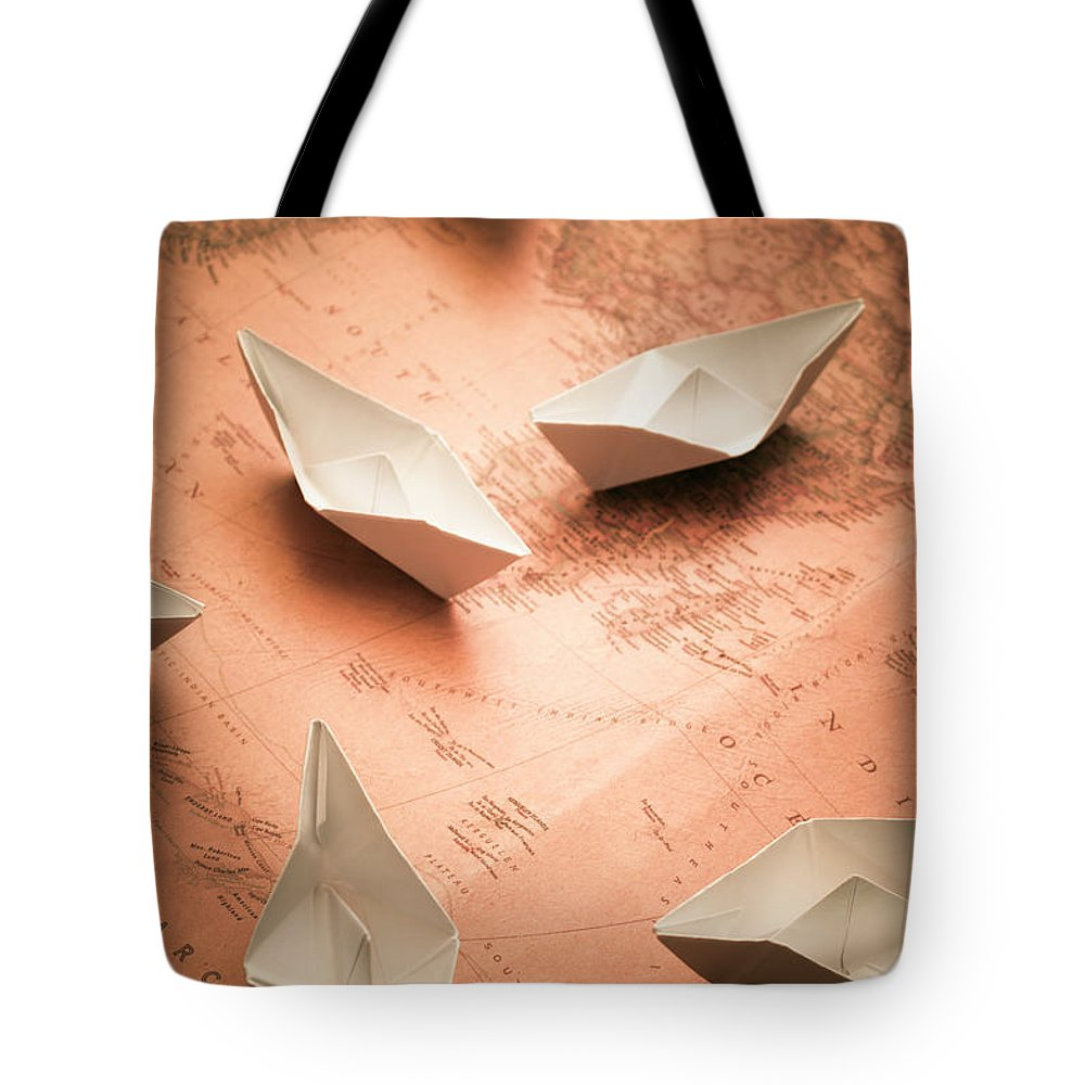 Cruise Tote Bag featuring the photograph Small Paper Boats On Top Of Old Map by Jorgo Photography - Wall Art Gallery
