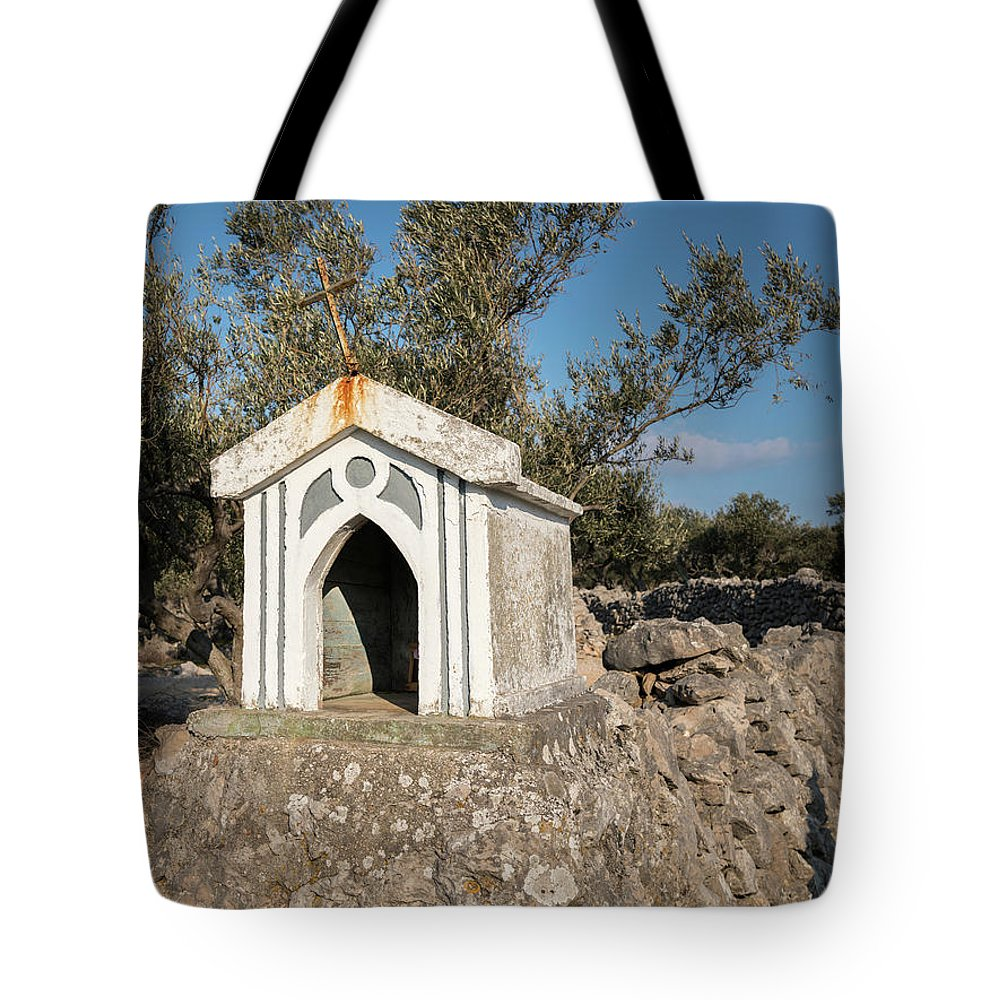 Religion Tote Bag featuring the photograph Small White Chapel On A Stone Wall Near Cres by Stefan Rotter