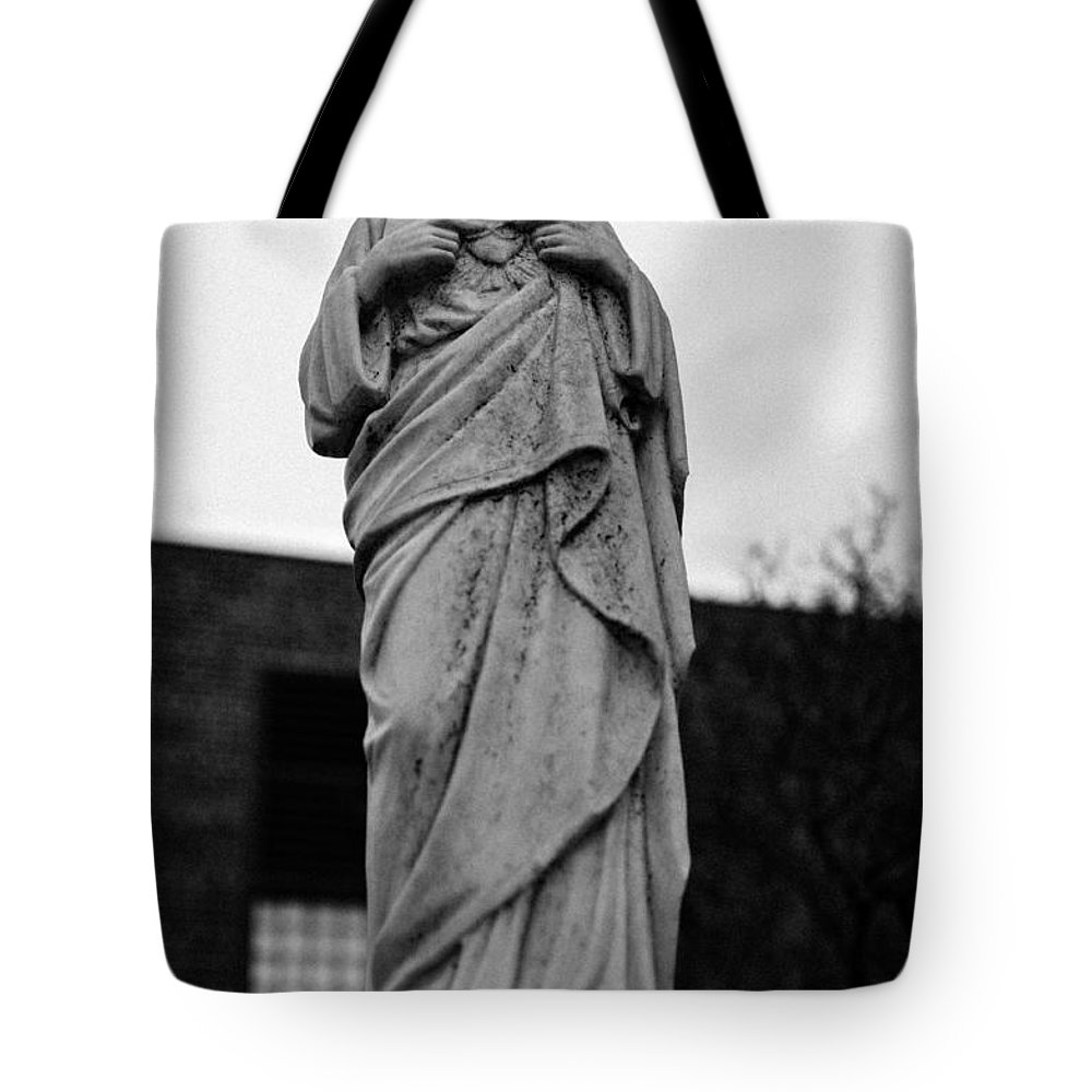 Antique Tote Bag featuring the photograph Smile Empty Soul by Robert Michaud