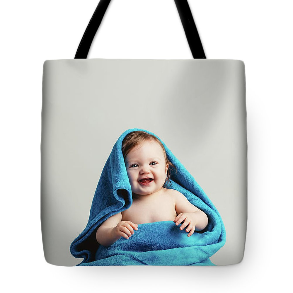 Baby Tote Bag featuring the photograph Smiling Baby Tucked In A Warm Blanket by Michal Bednarek