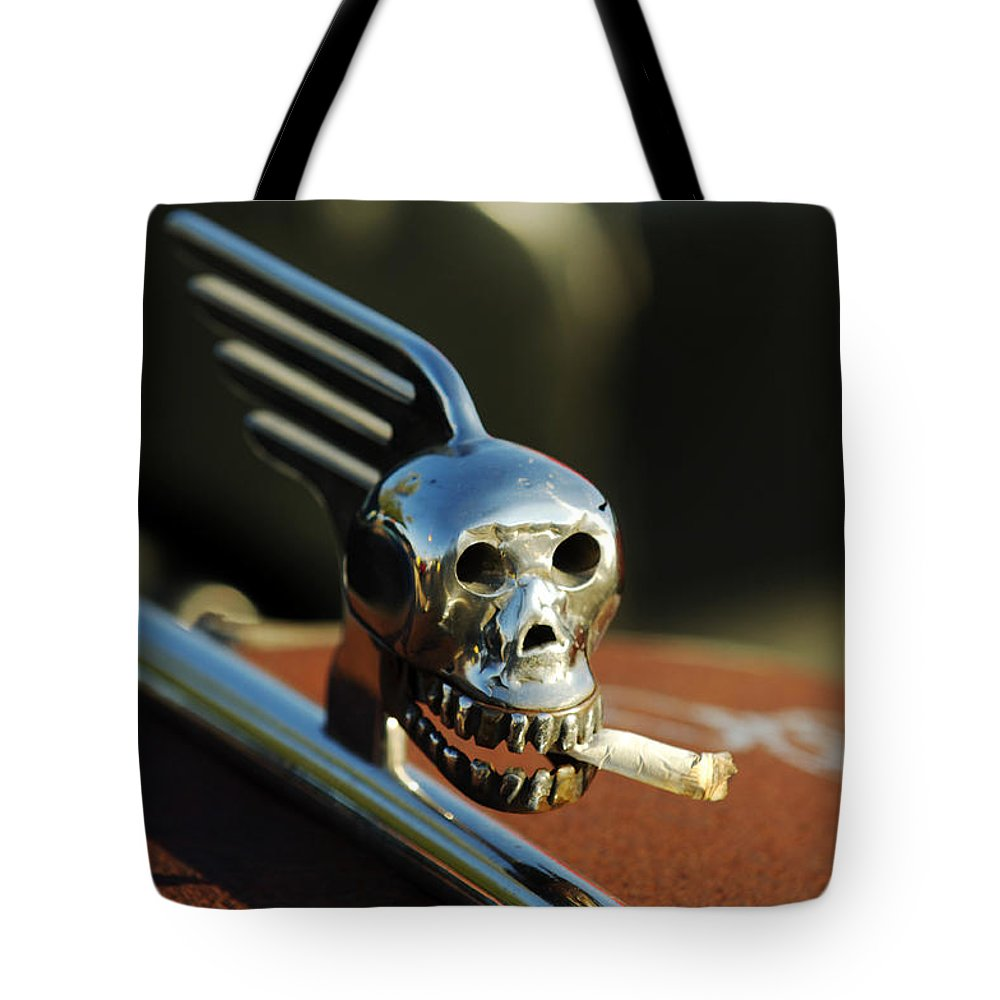 Transportation Tote Bag featuring the photograph Smoking Skull Hood Ornament by Jill Reger