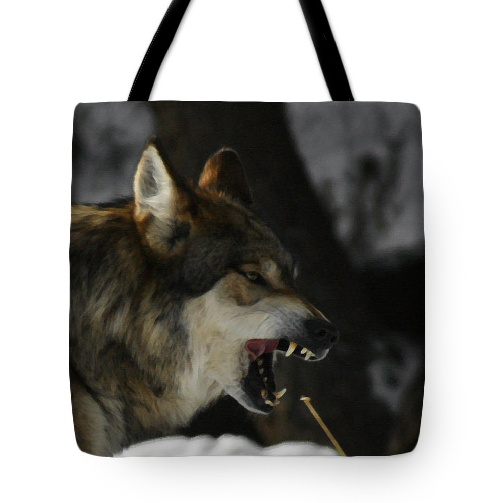 Wolf Tote Bag featuring the photograph Snarling Wolf by Ernie Echols