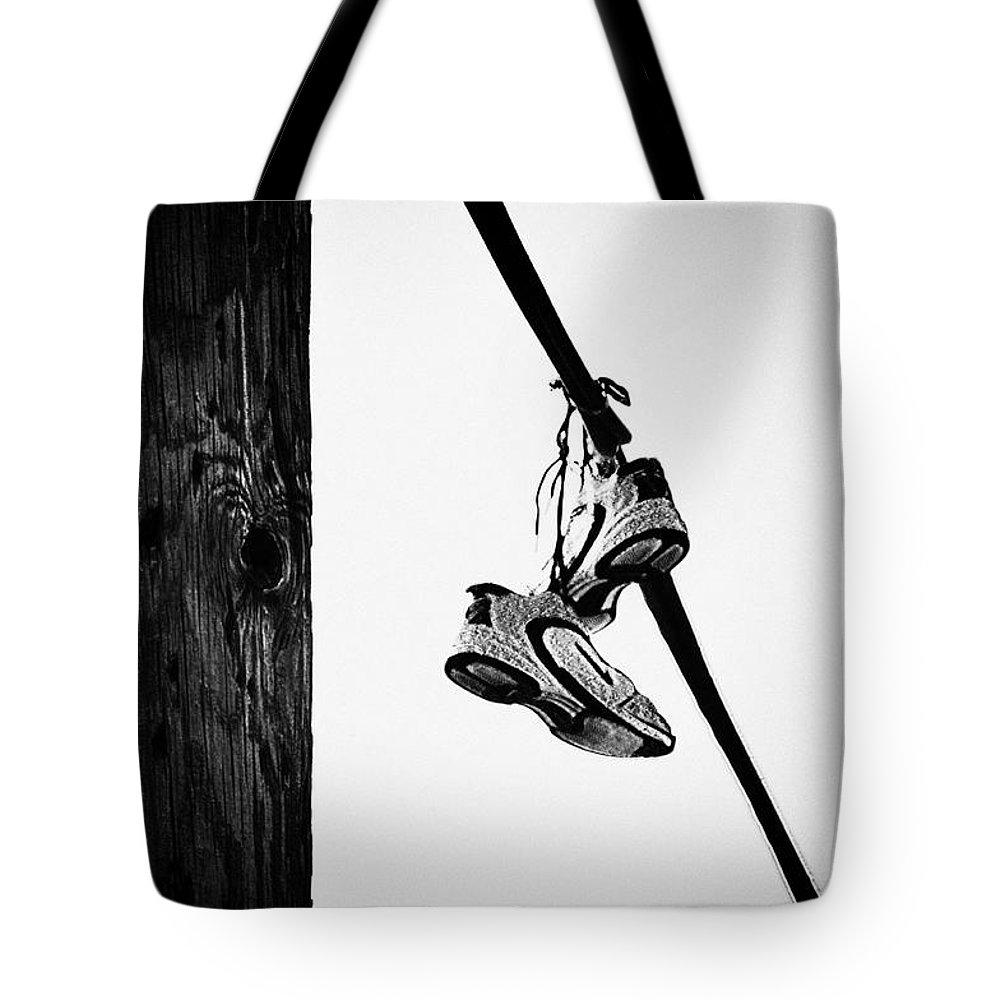 Philadelphia Tote Bag featuring the photograph Sneakers On Power Line by Bill Cannon