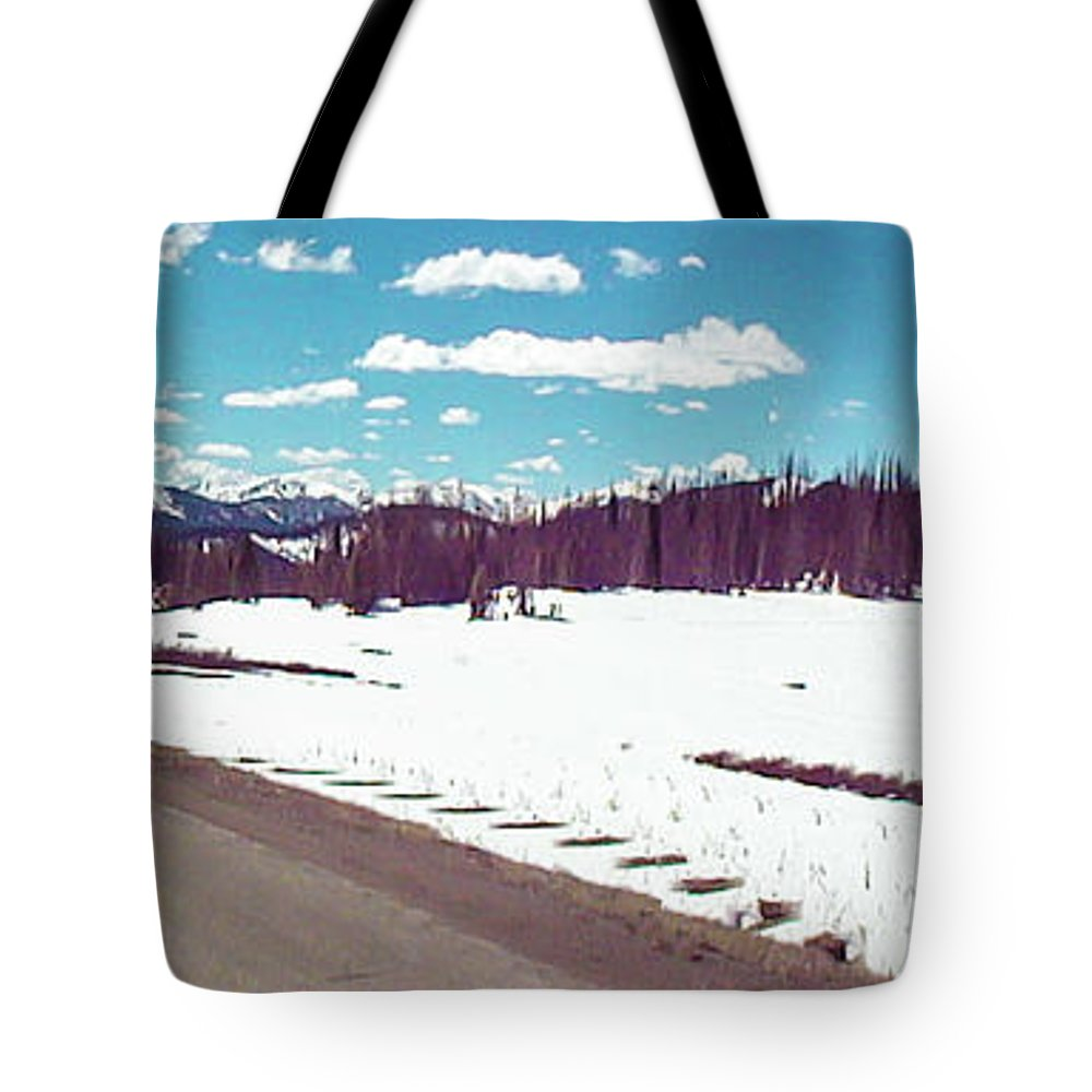 Snow Tote Bag featuring the photograph Snow And The Open Road by George Lehmann