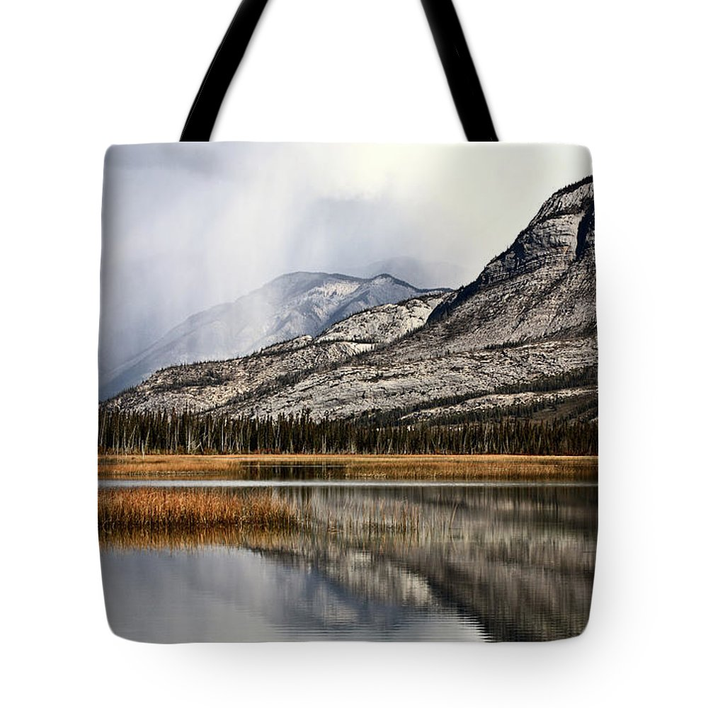 Rocky Mountains Tote Bag featuring the digital art Snow Clouds In The Rocky Mountains Of Alberta by Mark Duffy
