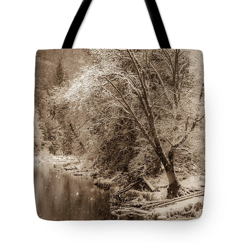 Alluring Images Llc Tote Bag featuring the photograph Snow Softly Falling On The Banks Of The Merced River by Bridget Calip