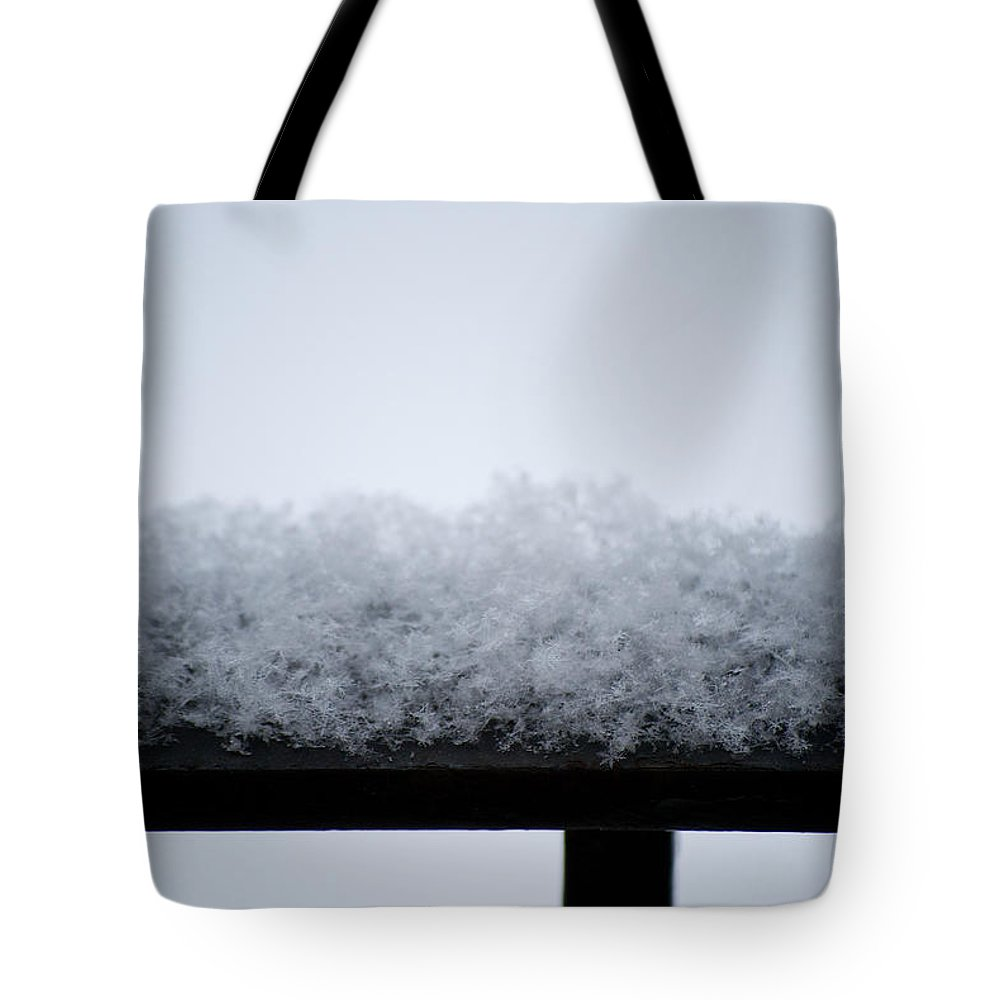 Iron Tote Bag featuring the photograph Snowflakes Chill The Iron by Lisa Knechtel