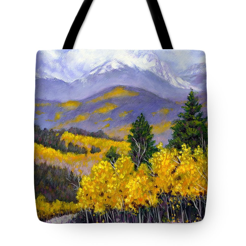 Rocky Mountains Tote Bag featuring the painting Snowing in the Mountains by John Lautermilch