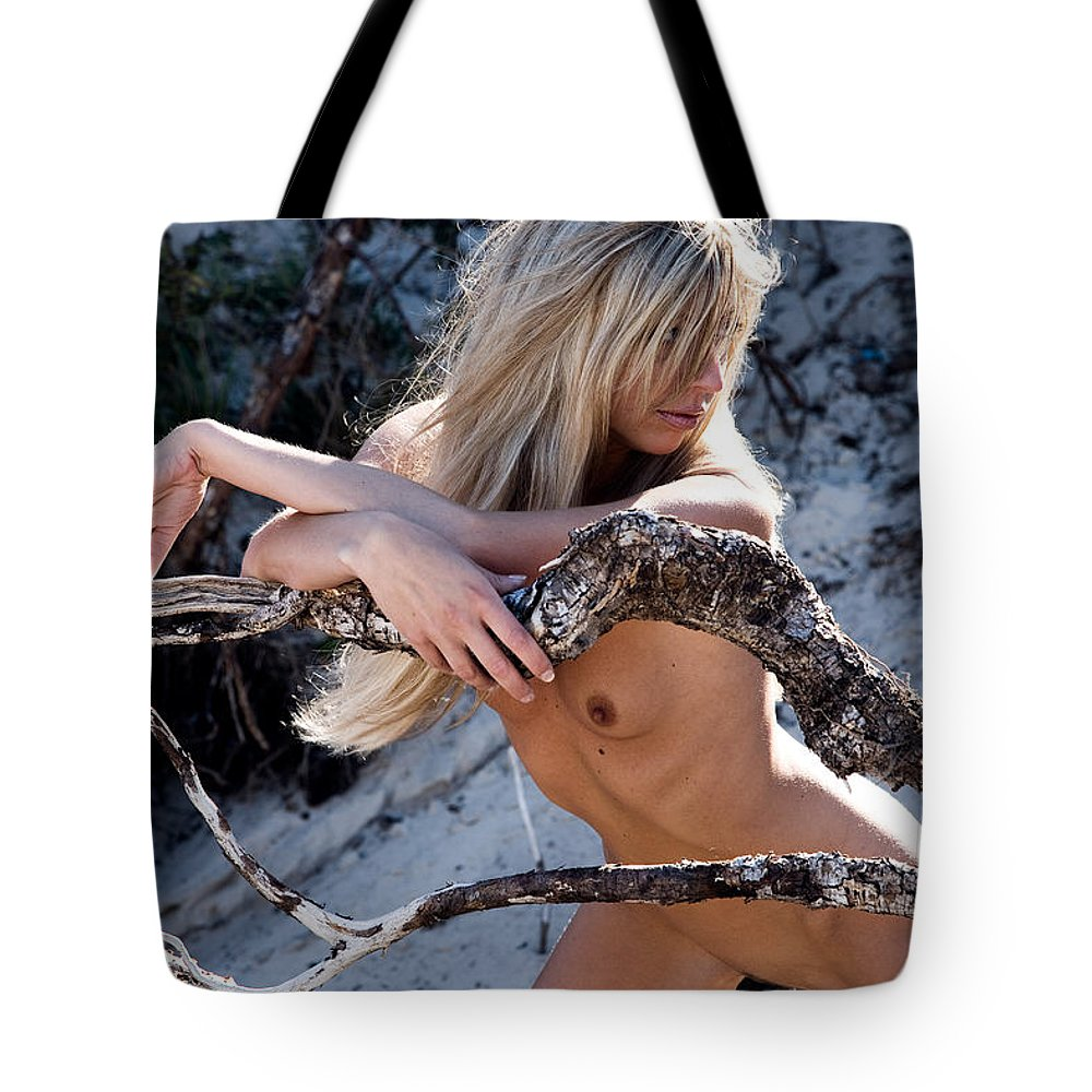 Sensual Tote Bag featuring the photograph So Far Away by Olivier De Rycke