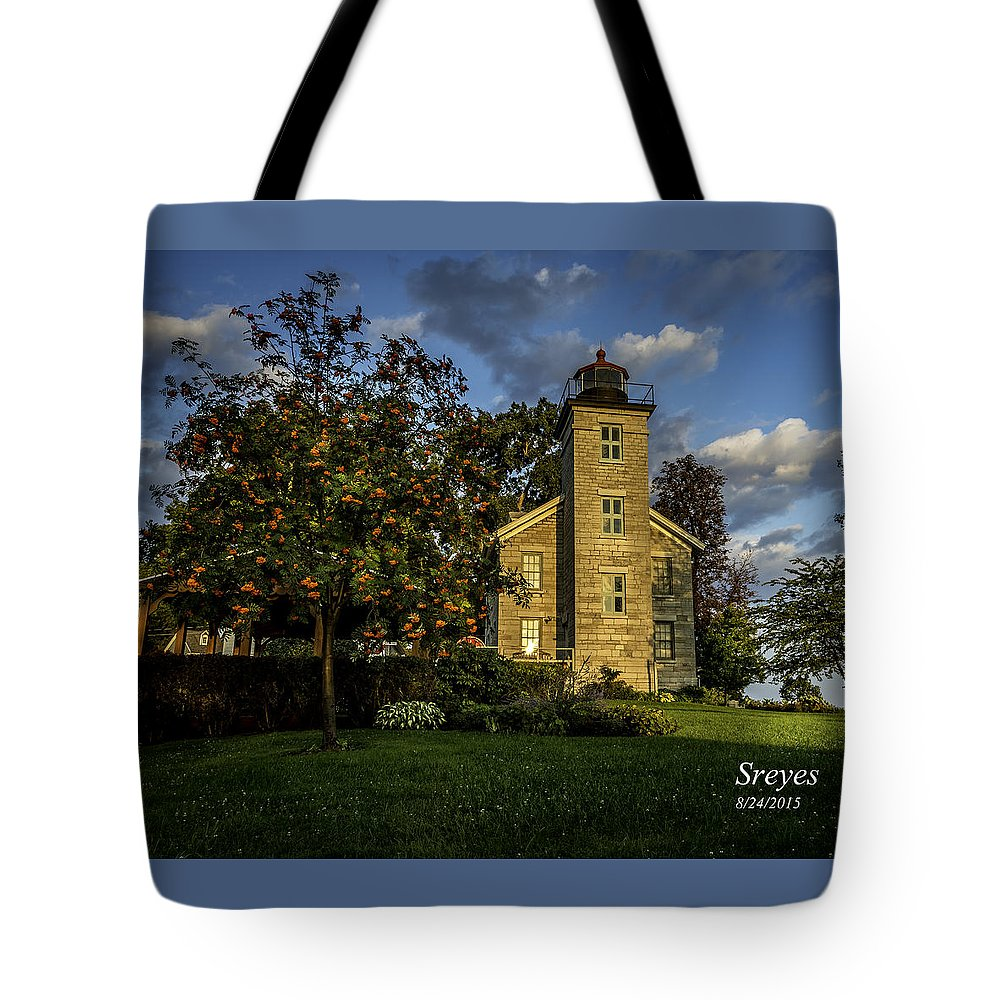 Sodus Point Ny Tote Bag featuring the photograph Sodus Point Big Lighthouse by Scott Reyes