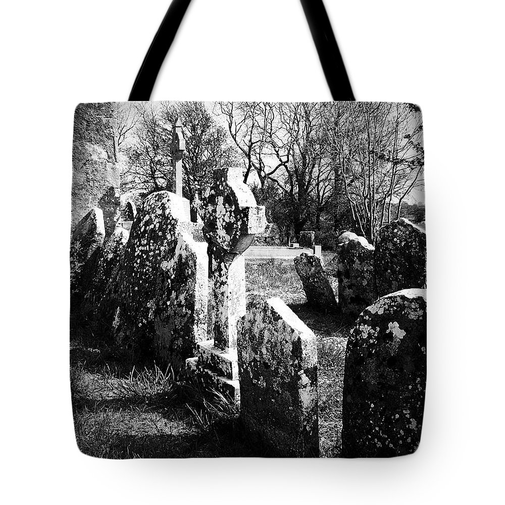 Ireland Tote Bag featuring the photograph Solitary Cross At Fuerty Cemetery Roscommon Irenand by Teresa Mucha