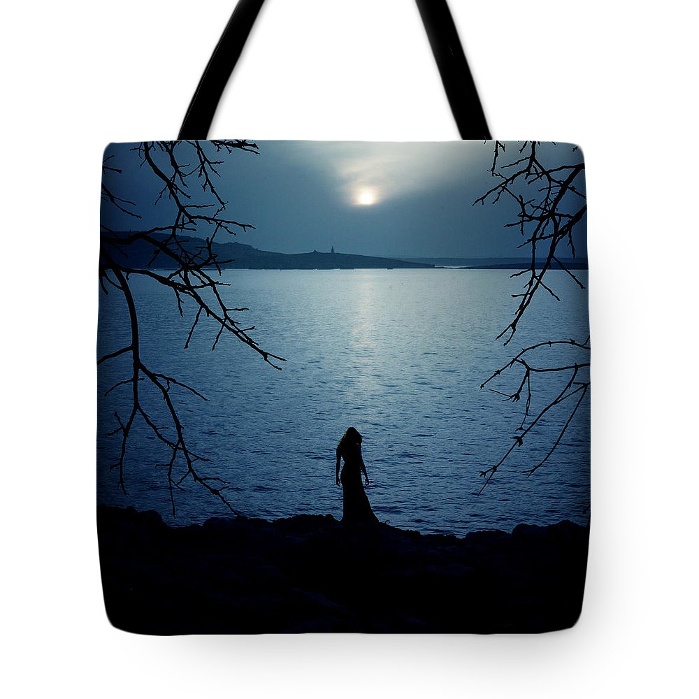 Beach Tote Bag featuring the photograph Solitude by Cambion Art