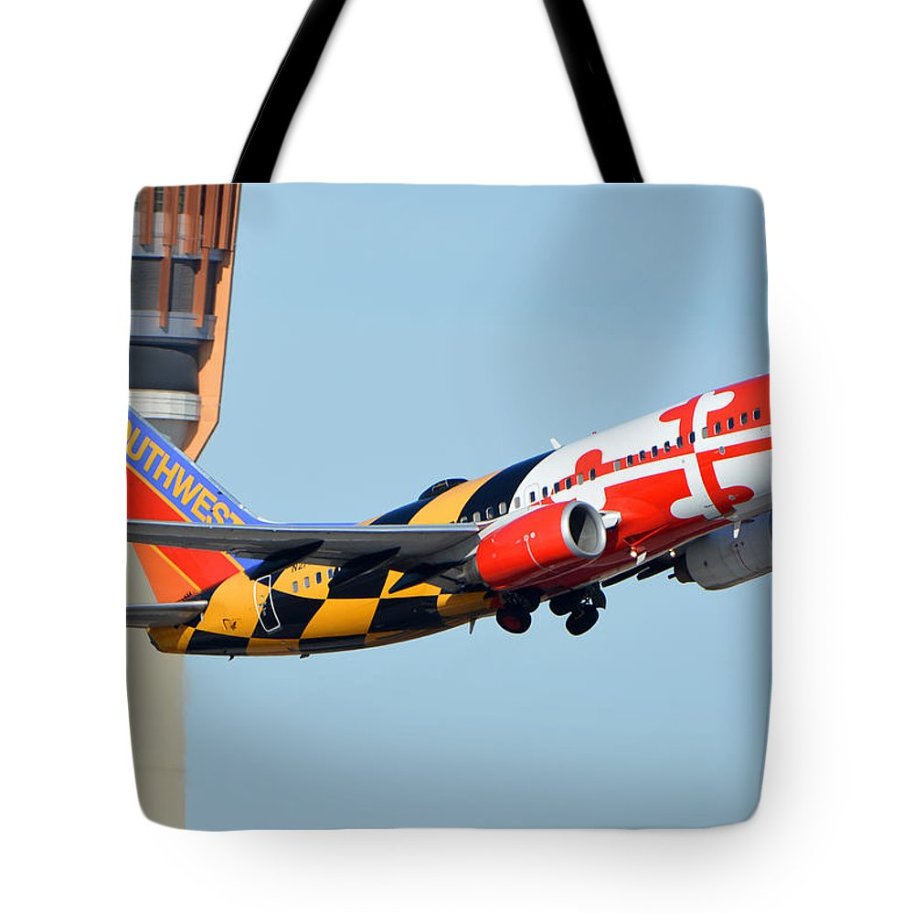 Airplane Tote Bag featuring the photograph Southwest Boeing 737-7h4 N214wn Maryland One Phoenix Sky Harbor January 19 2016 by Brian Lockett