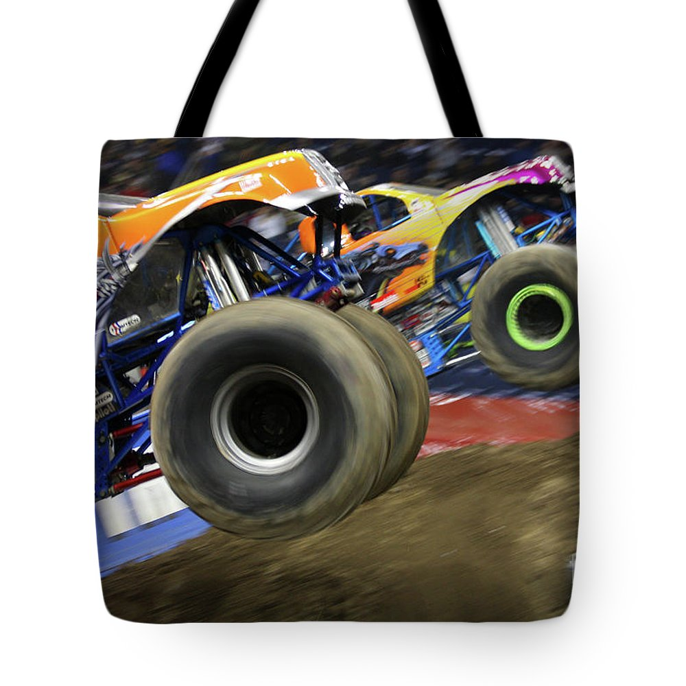 Vehicles Tote Bag featuring the photograph Speeding Tires by Karol Livote