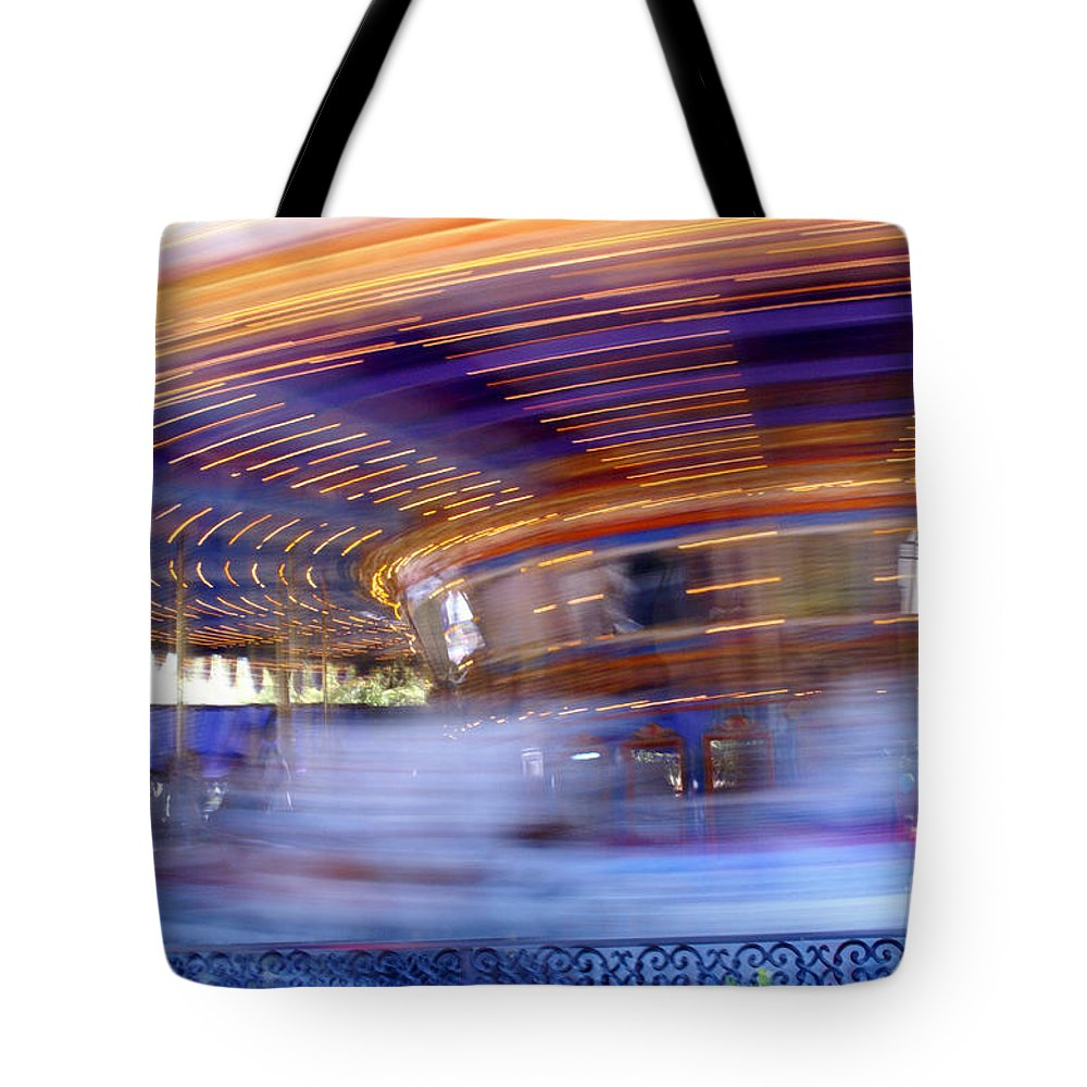 Carousel Tote Bag featuring the photograph Spin Faster by Linda Shafer