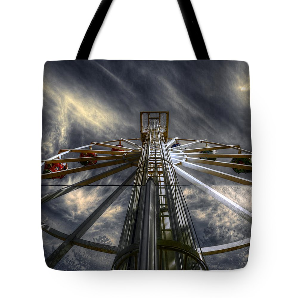 Amusement Tote Bag featuring the photograph Spinner by Wayne Sherriff