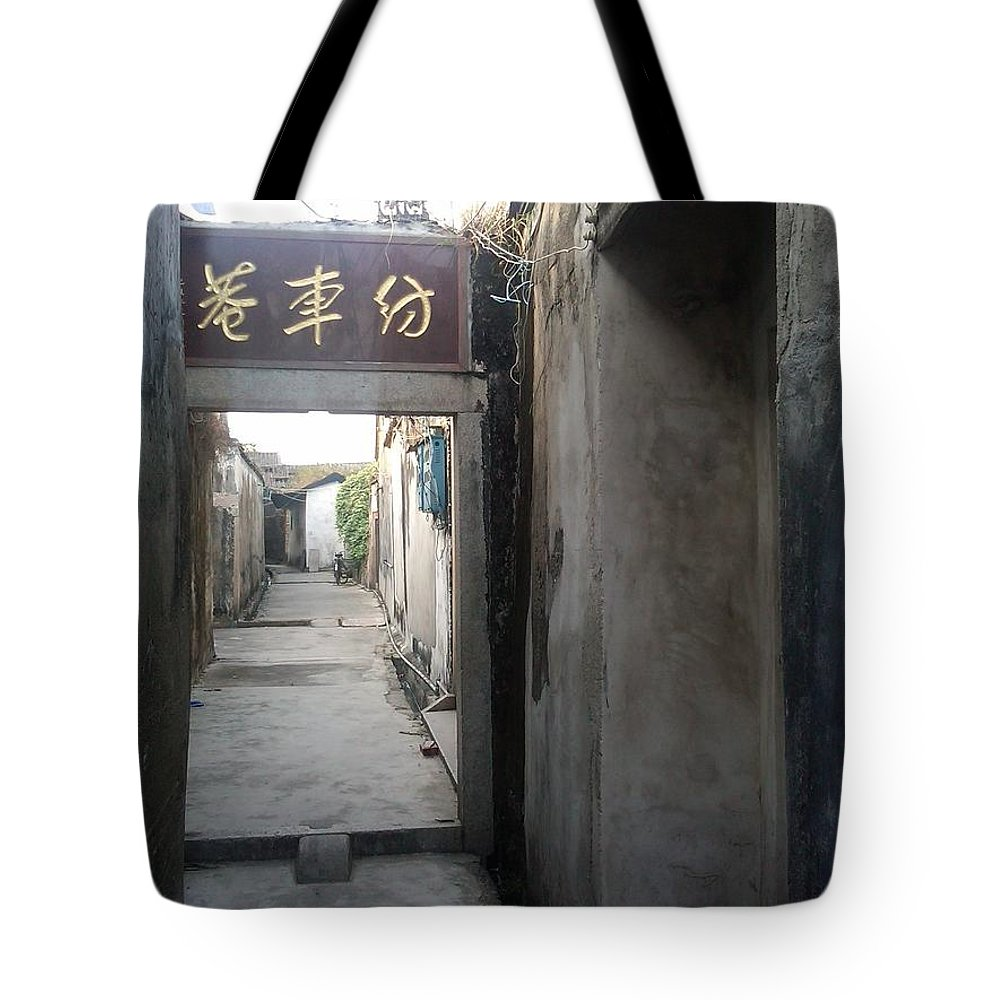 Chinese Village Tote Bag featuring the photograph Spinning Wheel Lane by Rauno Joks