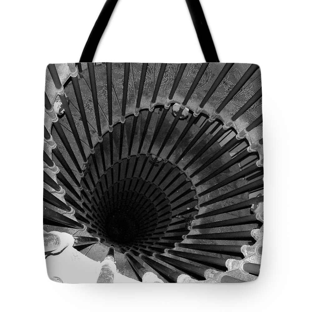 Spiral Staircase Tote Bag featuring the photograph Spiral Staircase In Lublijana by Donna Corless