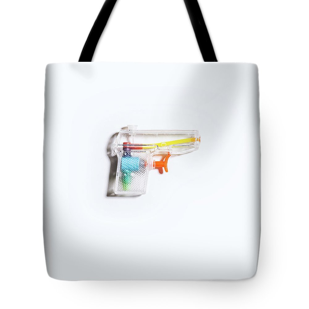 Still Life Tote Bag featuring the photograph Squirt Gun by Scott Norris