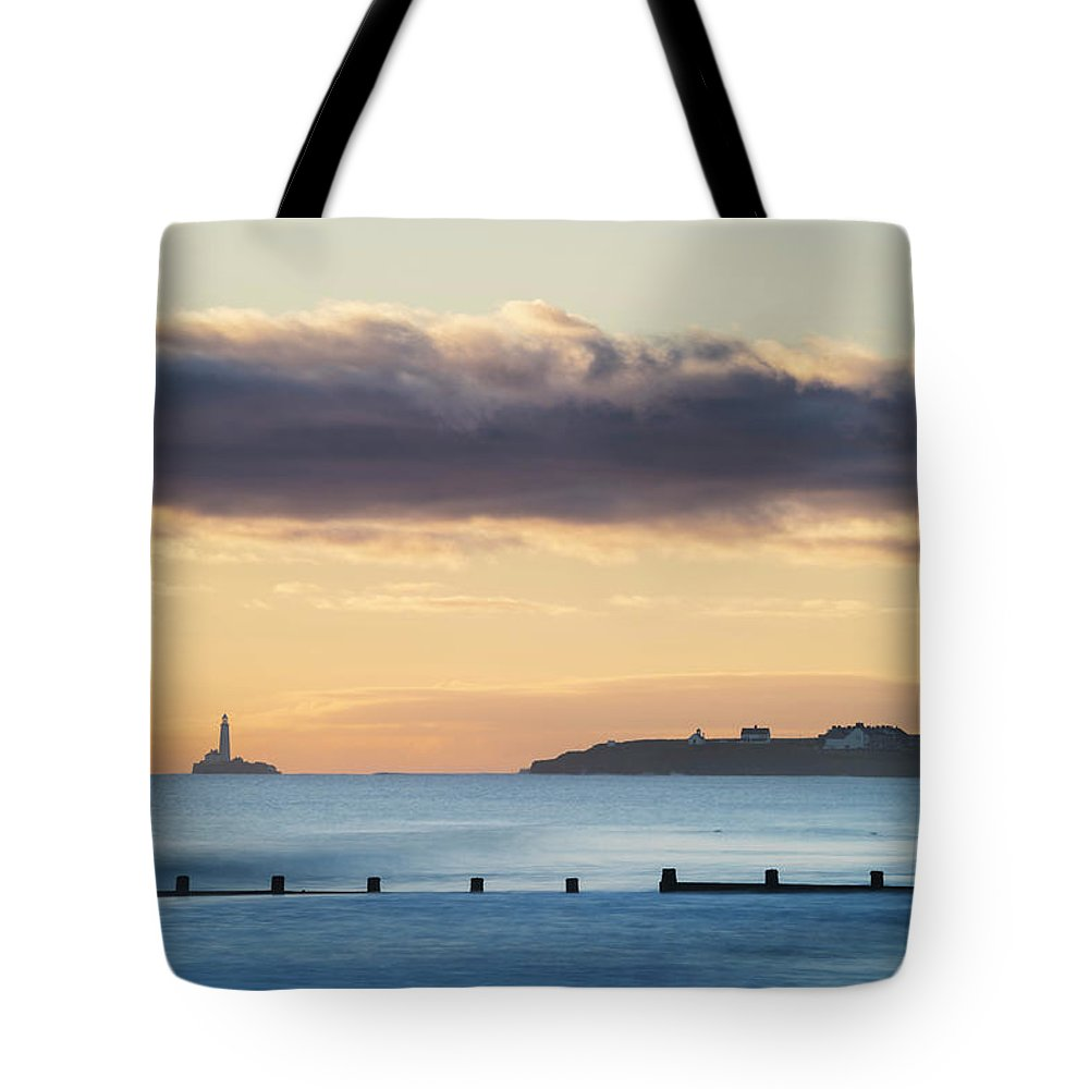 Beach Tote Bag featuring the photograph St Mary's Sunrise by David Taylor