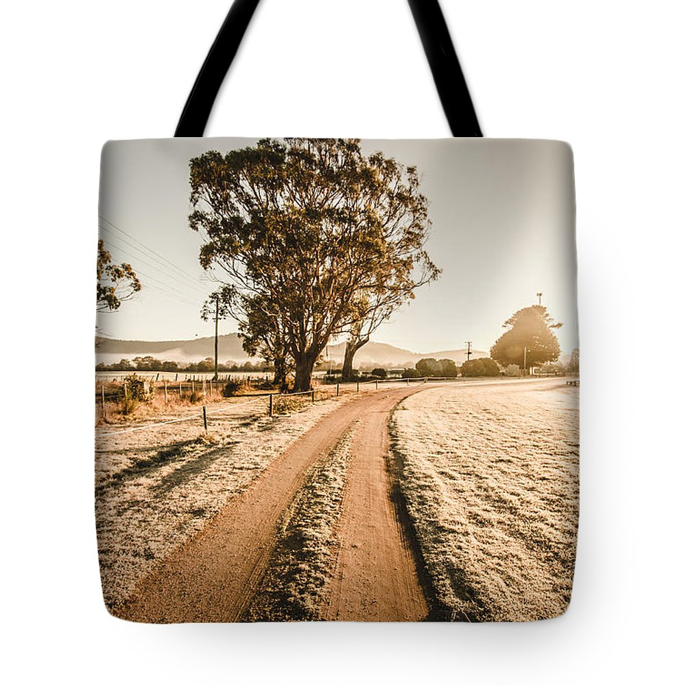 St. Marys Tote Bag featuring the photograph St Marys Winter Country Road by Jorgo Photography - Wall Art Gallery