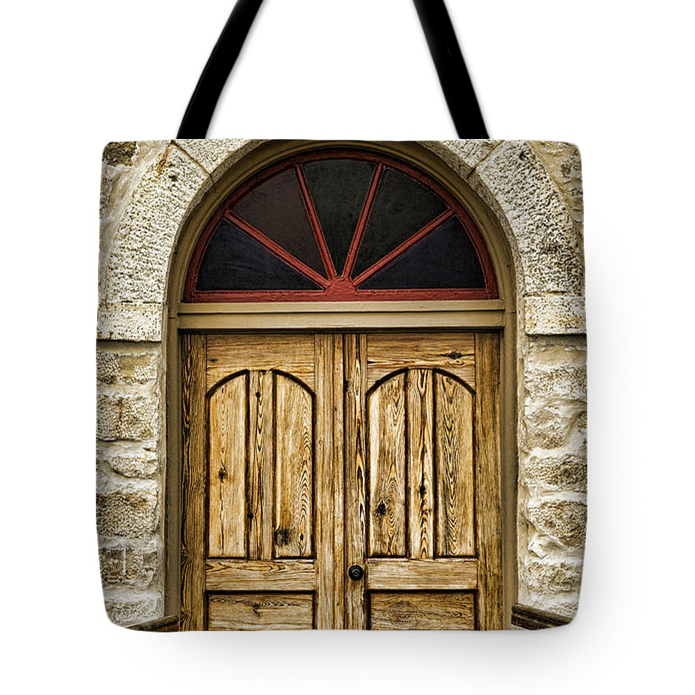 Texas Tote Bag featuring the photograph St Olafs Kirke Door by Stephen Stookey