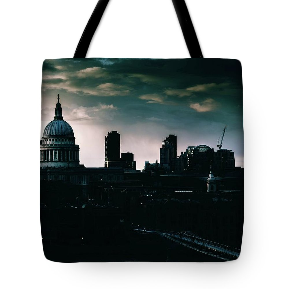 Architectural Feature Tote Bag featuring the photograph St Paul's Cathedral And Millennium Bridge In The Evening In London, England by Alexandre Rotenberg