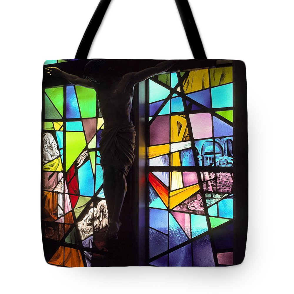 Stained Glass Window Tote Bag featuring the photograph Stained Glass With Crucifix Silhouette by Sally Weigand