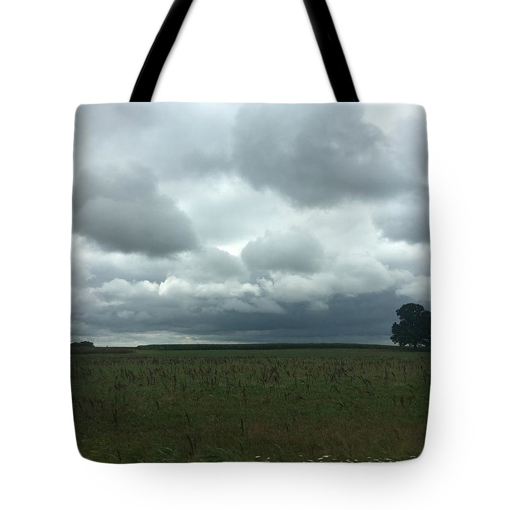 Tote Bag featuring the photograph Standing Strong Against The Impending Storm by Christine Rivers