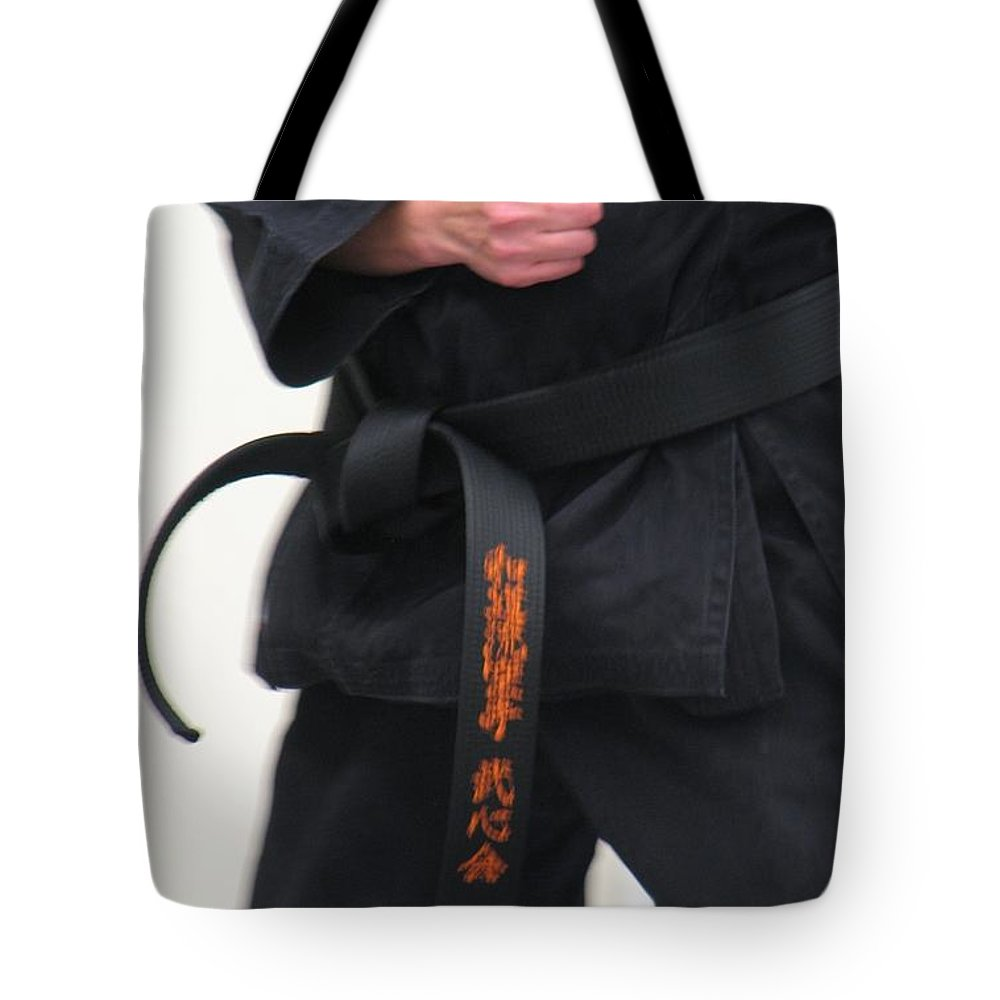 Karate Tote Bag featuring the photograph Stands With Fist by Kelly Mezzapelle
