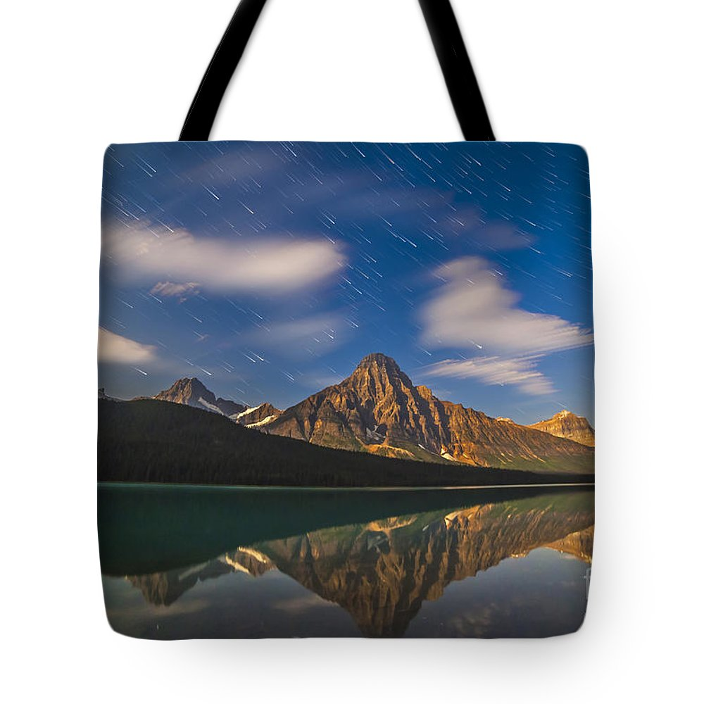 Banff National Park Tote Bag featuring the photograph Star Trails Behind Mount Chephren by Alan Dyer