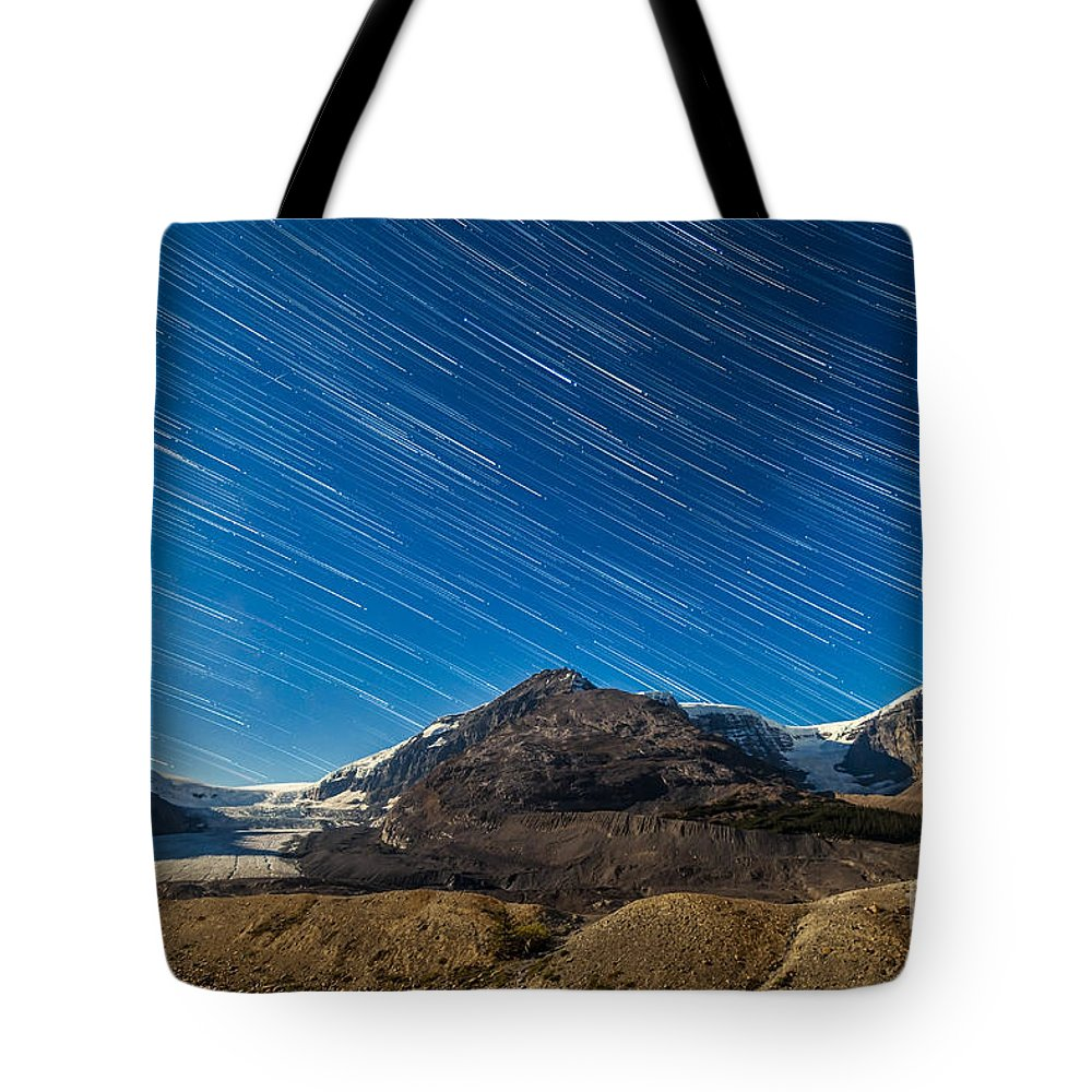 Athabasca Glacier Tote Bag featuring the photograph Star Trails Over Columbia Icefields by Alan Dyer