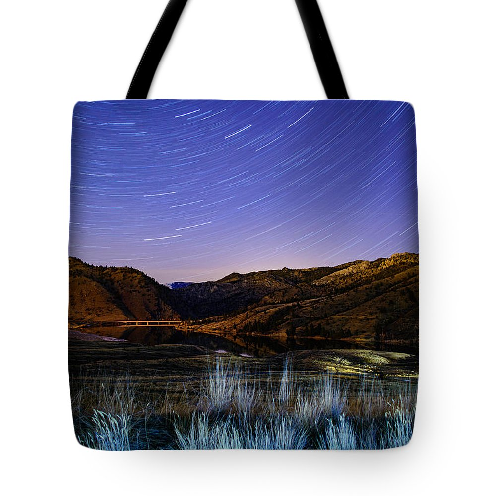 Nightscape Tote Bag featuring the photograph Star Trails Over Hauser by Tory Stephens