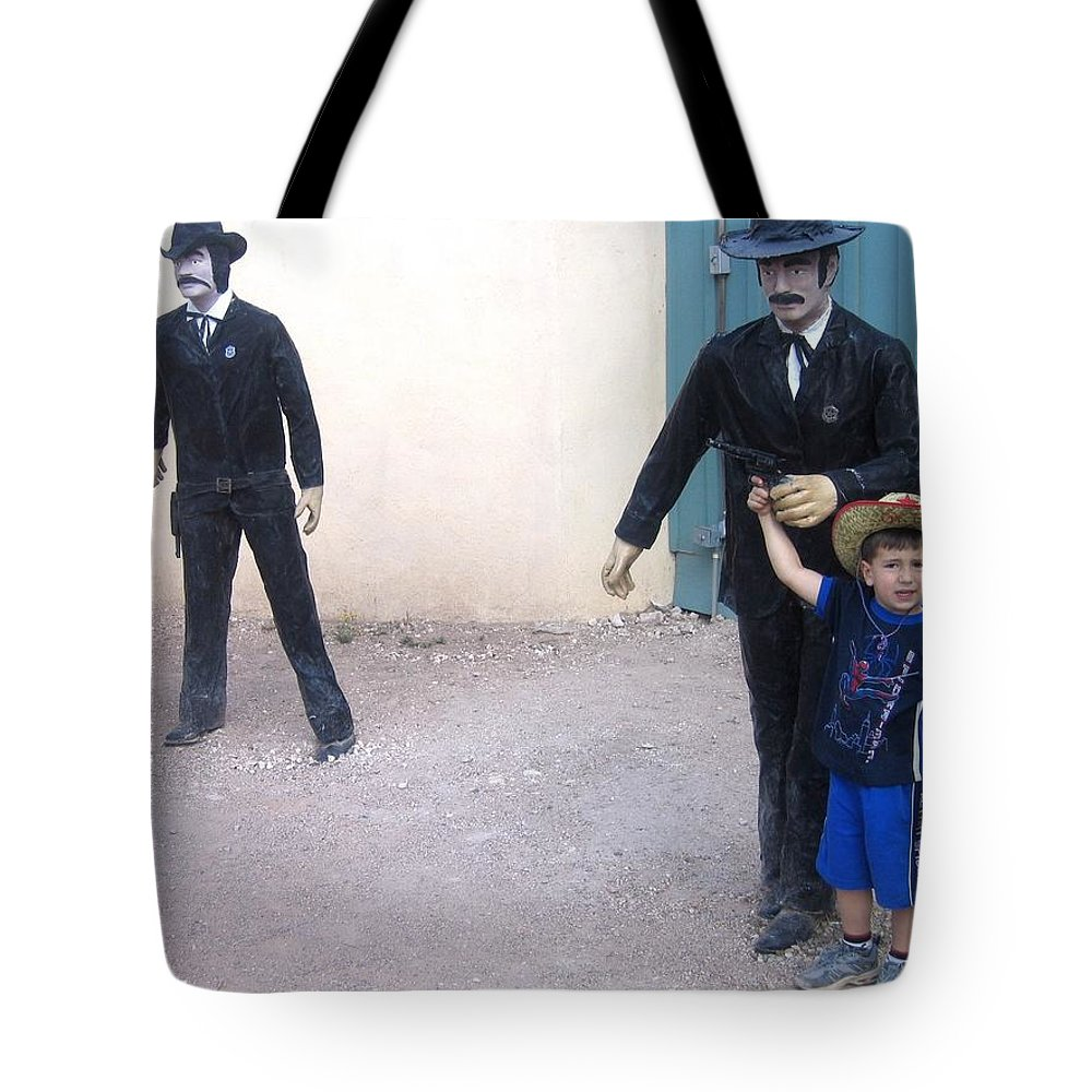 Statues Depicting Shooters In O.k. Corral Gunfight Tombstone Arizona 2004 Tote Bag featuring the photograph Statues Depicting Shooters In O.k. Corral Gunfight Tombstone Arizona 2004 by David Lee Guss