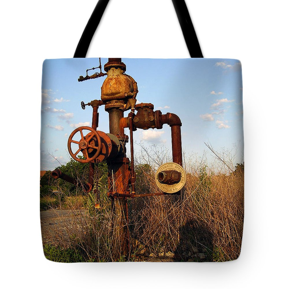 Pipes Tote Bag featuring the photograph Still Here by Flavia Westerwelle