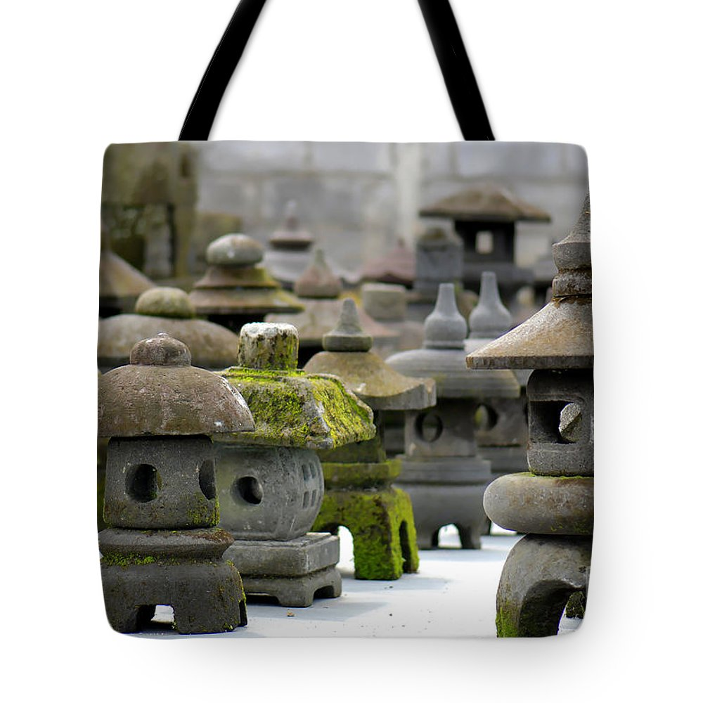 Figures Tote Bag featuring the photograph Stone Figures by Charuhas Images