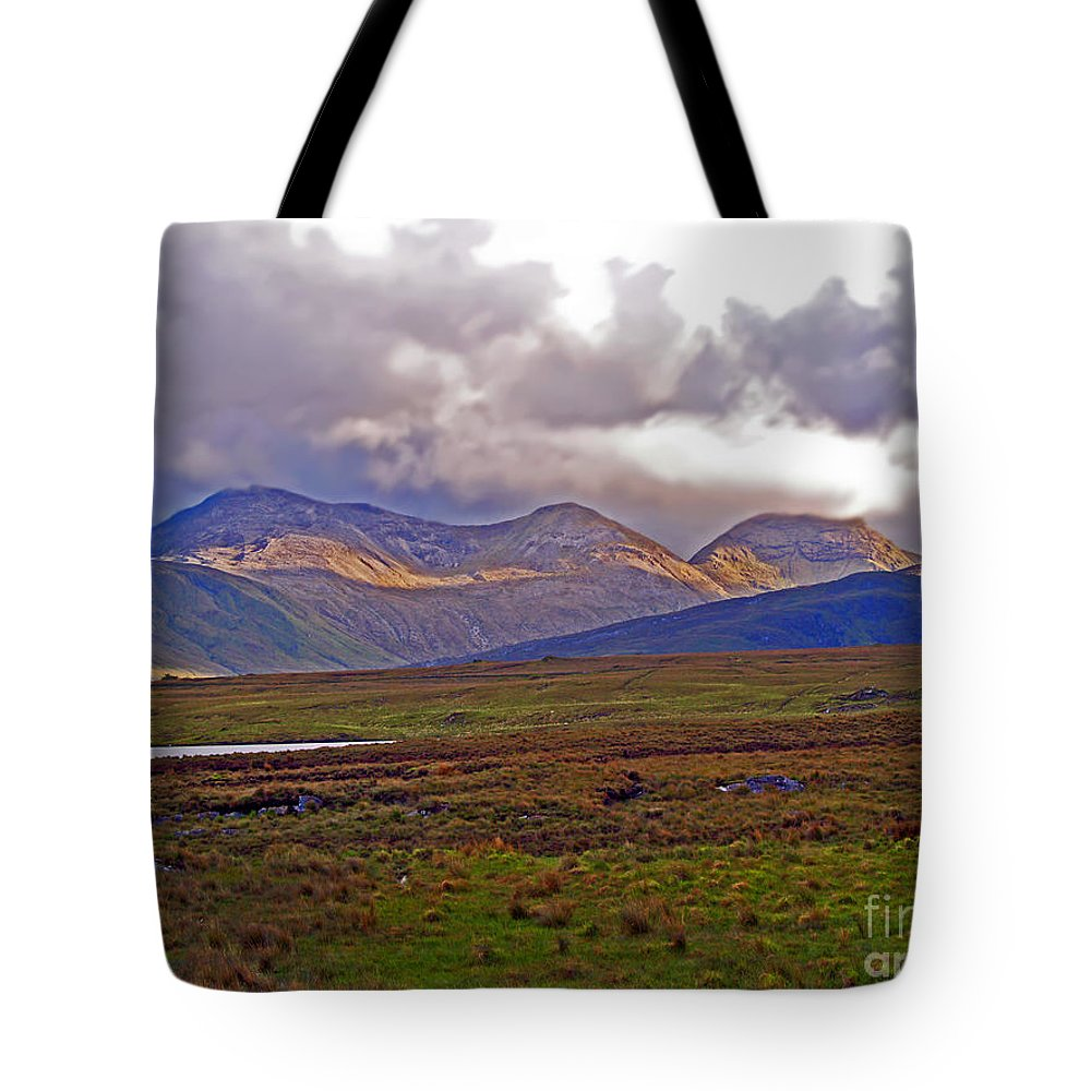Fine Art Photography Tote Bag featuring the photograph Storm Clouds Ahead In Connemara by Patricia Griffin Brett