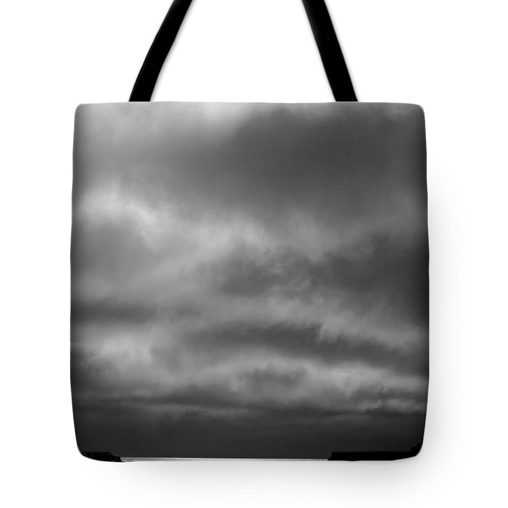 Tote Bag featuring the digital art Storm Clouds Approaching Boat On Northern Saskatchewan Lake by Mark Duffy